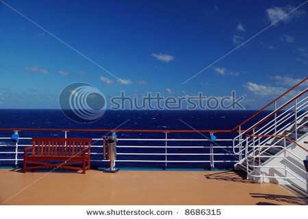 Stock-photo-scenic-view-of-top-deck-on-cruise-ship-with-caribbean-in-the-background-8686315